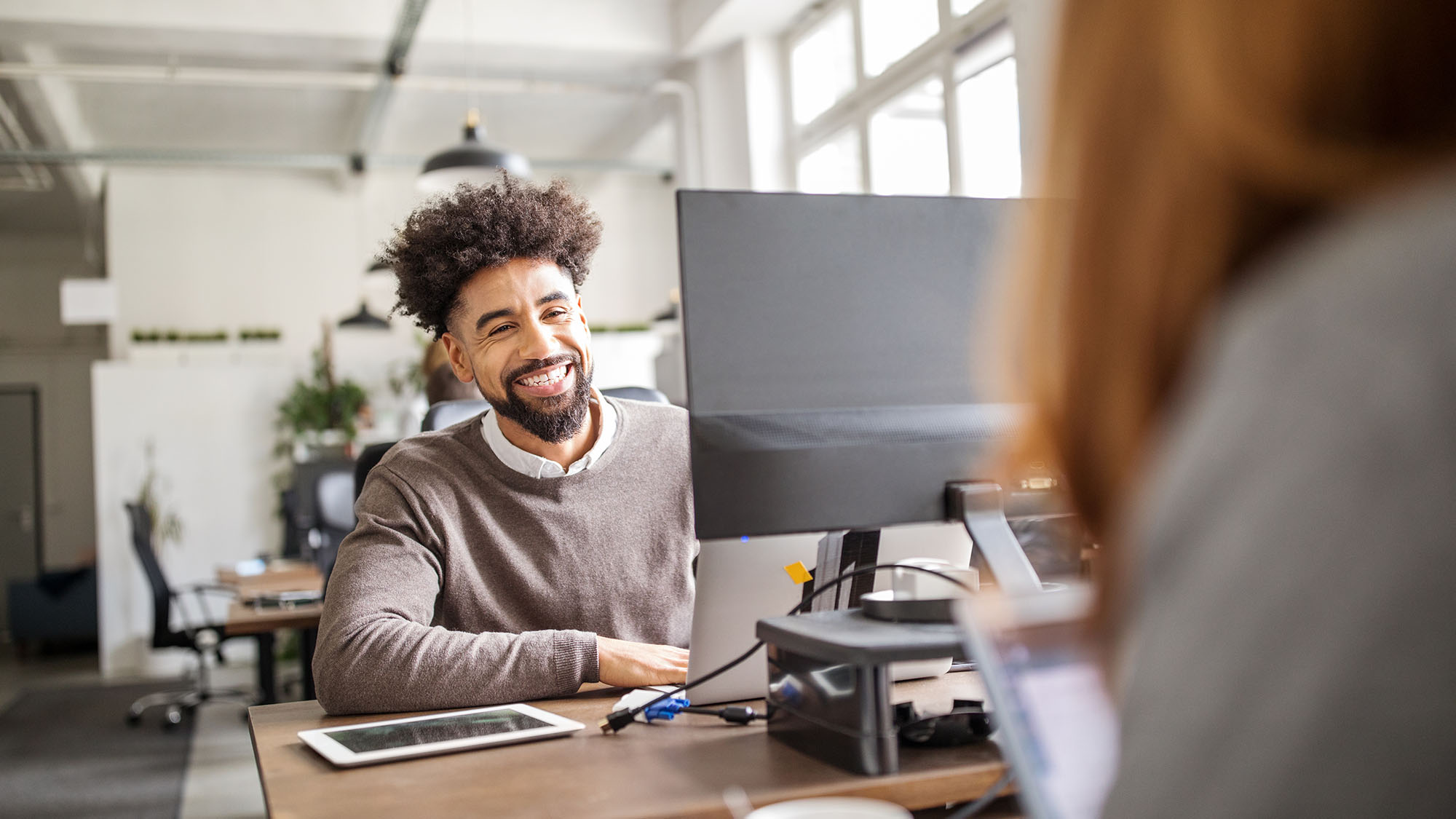 Happy business professionals working in office